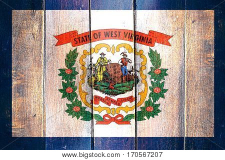 Vintage west virginia flag on grunge wooden panel