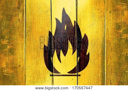 Vintage Flammable hazard sign on a grunge wooden panel