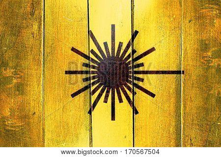 Vintage Laser warning symbol on a grunge wooden panel