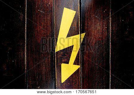 Vintage High voltage sign on a grunge wooden panel
