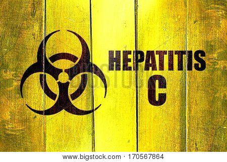 Vintage Hepatitis C on a grunge wooden panel
