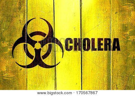 Vintage Cholera on a grunge wooden panel