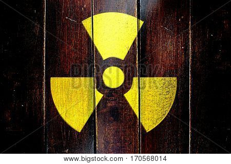 Vintage Radioactive warning on a grunge wooden panel