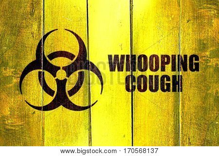 Vintage Whooping cough on a grunge wooden panel