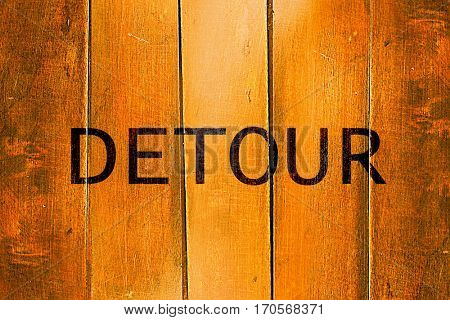 Vintage detour sign on a grunge wooden panel