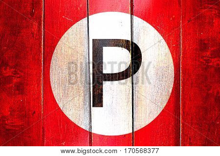 Vintage parking not allowed on a grunge wooden panel