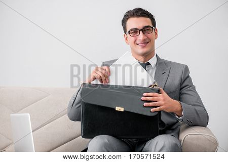 Businessman with briefcase in business concept