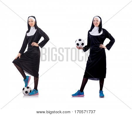 Pretty nun with football ball isolated on white
