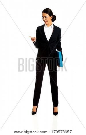 Businesswoman pointing to the corner