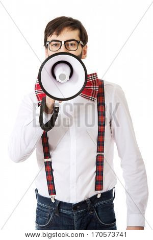 Man wearing suspenders with megaphone.
