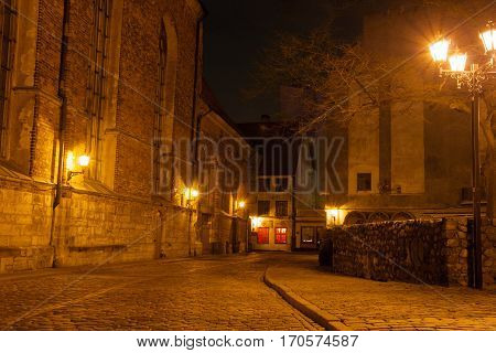 Riga, Latvia - March 04, 2014: Romantic ancient street in old city. The old town of Riga is listed under the UNESCO world heritage sites.