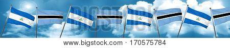 nicaragua flag with Botswana flag, 3D rendering