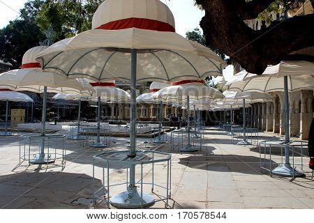 White domed umbrella stands in open dining area at City Palace in Udaipur Rajasthan India Asia