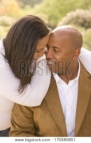 Loving African American couple laughing and hugging.
