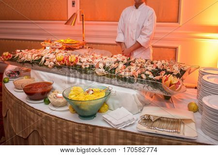 Buffet table with seafood with shrimp and crabs on luxury event banquet. Cathering service concept.