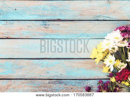Colorful flowers bouquet on vintage wooden background border design. vintage color tone - concept flower of spring or summer background