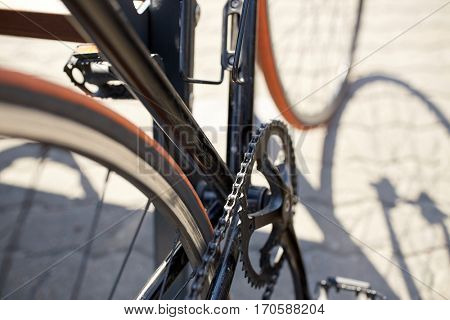 transport and vehicle concept - close up of fixed gear bicycle on city street
