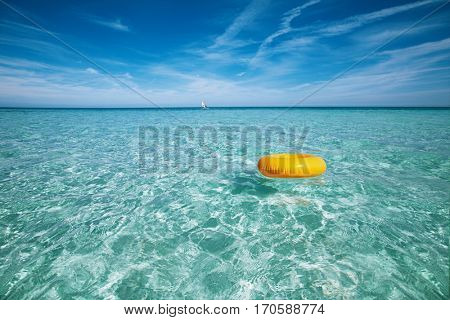 floating ring on blue clear sea and sky, shallow dof