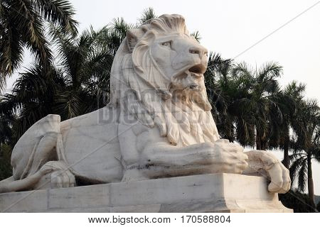 KOLKATA, INDIA - FEBRUARY 08: Antique Lion Statue at Victoria Memorial Gate, Kolkata, India, sculptured by Vincent Esch in Kolkata, West Bengal, India on February 08, 2016