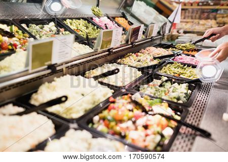 Close up view of an appetizing buffet of prepared meal in grocery store