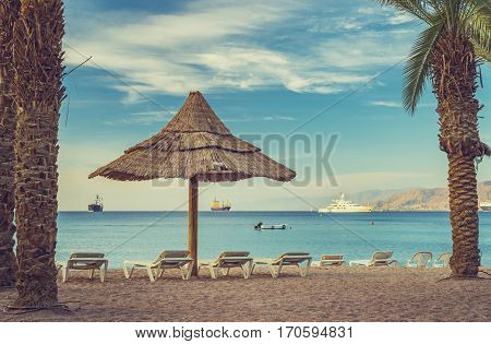 Relaxing facilities on central public beach of Eilat - famous resort city in Israel