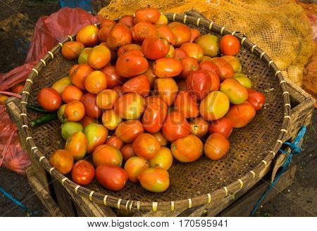 Red tomatoes on a bamboo basket photo taken in Bogor Indonesia java