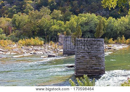 Shenandoah River with old bridge remains in Harpers Ferry West Virginia USA. Appalachian trail in Harpers Ferry National Historical Park.
