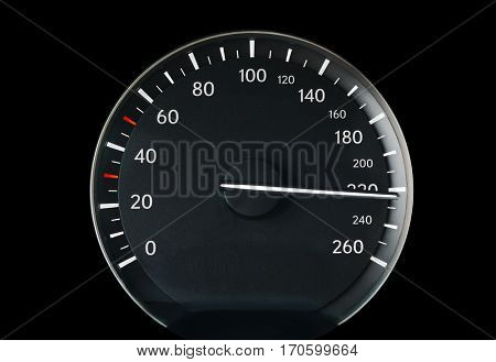 Speedometer of a car showing 220, racing sports car