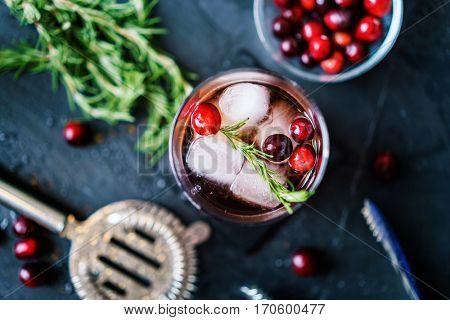 cranberry and rosemary cocktail in flay lay composition