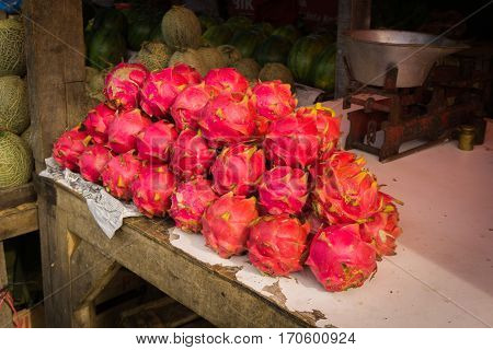 Red dragon fruits stacked on a table ready to sell photo taken in Bogor Indonesia java