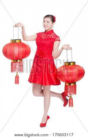 young asian woman in red cheongsam holds red lantern in chinese new year