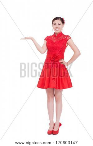young asian woman in red cheongsam with gesture in chinese new year