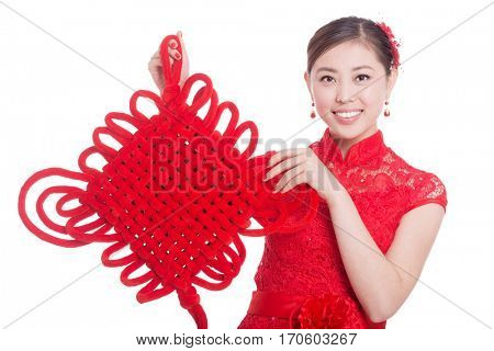 young asian woman in red cheongsam holds red chinese knot in chinese new year