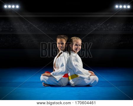 Girls martial arts fighters in sports hall