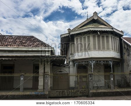 Abandoned old house building with beautiful cloudy sky as background photo taken in Bogor Indonesia java