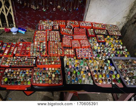 Various kind and colourful of gemstones and agate sold in traditional market in Bogor Indonesia java poster