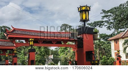 Red gateway from Chinese temple with yellow lampion photo taken in Bogor Indonesia java