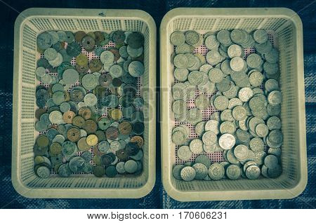 Collection of indonesia's coins displayed on a plastic basket photo taken in Bogor Indonesia java