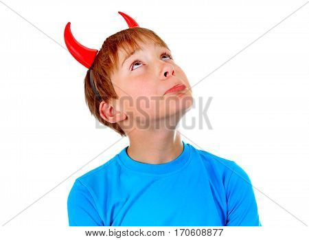 Pensive Kid with Devil Horns Isolated on the White Background