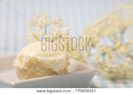 Homemade elderberry blossom ice cream ball with fresh elderflowers