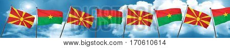 Macedonia flag with Burkina Faso flag, 3D rendering