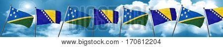 Solomon islands flag with Bosnia and Herzegovina flag, 3D render