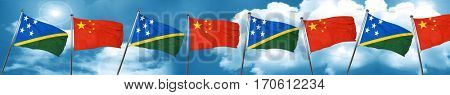Solomon islands flag with China flag, 3D rendering