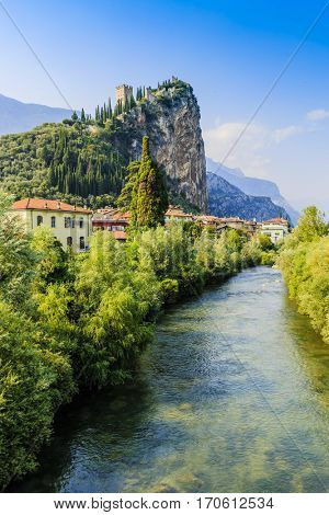 Cliffs of Arco di Trento, Trentino Italy.Climbing rock walls with castle in Arco of Trento and Sarca river near the Garda Lake in Trentino Alto Adige, Italy, Europe