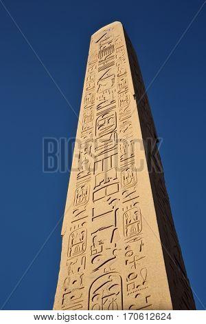 Obelisk on blue sky background in the Karnack temple