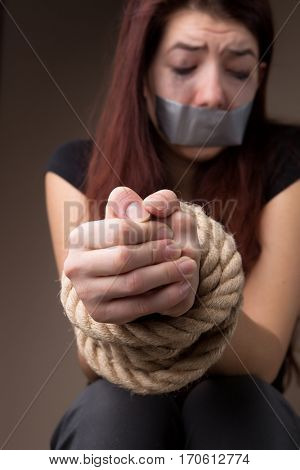 Victim girl with tied hands