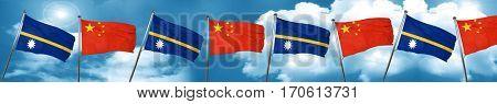 Nauru flag with China flag, 3D rendering