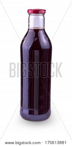 glass bottle with a lid with pomegranate juice on white