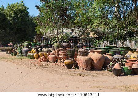 BAGAN, MYANMAR - DECEMBER 23, 2016: Pottery for sale on street of Old Bagan