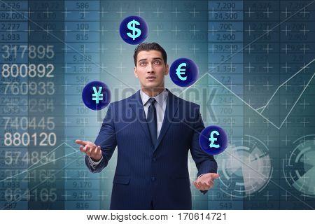 Businessman juggling between various currencies